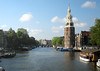 Montelbaanstoren Tower (1512) - originally it was a portion of the protective wall, a military tower to keep watch over the city from invading armies - here along the Oude Schans (Old Swans) Canal - at the northeastern section of the Old Center district - Amsterdam
