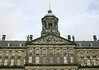 Sculptured tympanym upon the sandstone pediment - up to the oxidized copper domed cupola - of the Royal Palace - Amsterdam