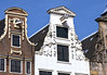 Historic merchant warehouses, both with the hoists still protruding from Bell gable and Neck gable - Amsterdam