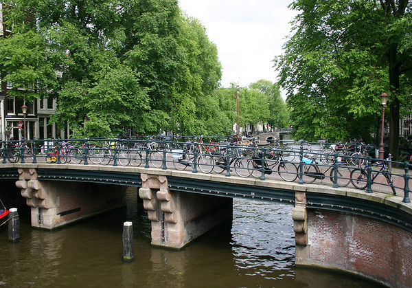 "Bicycles - the main means of transportation for the local residents of the inner districts (Old Center, Grachtengordel ""Canal Ring"", Jordaan, and Plantage) of Amsterdam, with many streets and bridges closed to vehicles."