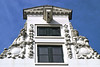 Hoist protruding from atop a neck gable from a historic merchants warehouse - Amsterdam