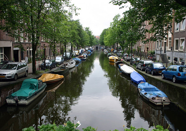 Boats and autos along a canal in the Jordaan district - Amsterdam