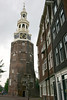 Montelbaanstoren Tower (1512), with the decorative spire and clock added in 1606 - originally it was a piece of the protective wall, which housed military guards, stationed here to keep watch for any armies who might have intentions of overtaking the city - now its home to the offices of Amsterdam's Department of Sewage and Water Management