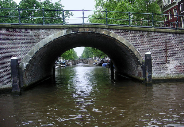 """The canals of Amsterdam have been part of the city's landscape since the early 14th century, however most of the current canals were built during the 17th century, Amsterdam's golden age - the 3 main canals (Herengracht """"Lord's Canal"""", Prinsengracht """"Prince's Canal"""", and Keizersgracht """"Emperor's Canal"""") form concentric belts around the city known as the Grachtengordel, a UNESCO World Heritage Site - the canals are flushed three times a week when the locks are open and water flows in from the North Sea."""