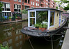 Houseboat along a canal in the Jordaan district - Amsterdam