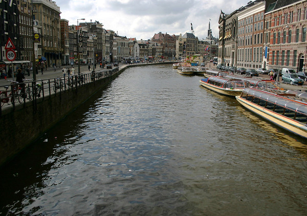 Down Rokin Canal - with the Oude Turfmarkt (Old Peat Market) on the right, and the Rokin street left, which leads directly to the Central Train Station - Amsterdam
