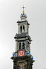 Tower of the Westerkerk (West Church - constructed in 1638, rising 279 ft. (85 m), the highest church tower in Amsterdam - the carillon consists of 50 bells, with the hour bell the heaviest in Amsterdam, weighing about 3,400 lb. (7,500 kilos) - and crowned with the Imperial Crown of Austria of Maximilian I and a gilded cock atop