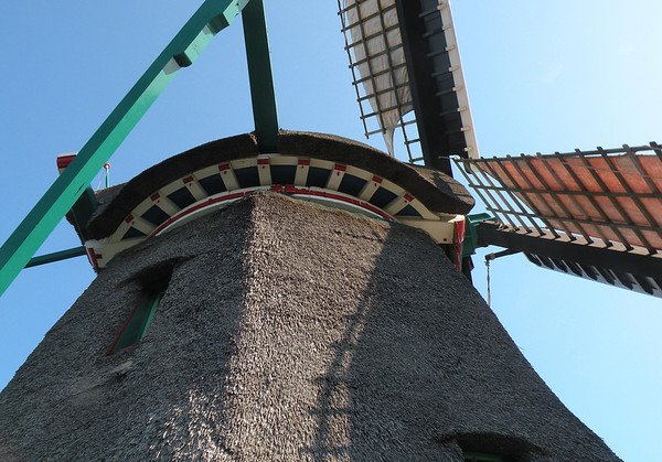 Up your Windmolen (windmill) - thatch walls and roof under a naked sky in the North Holland province