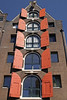 Refurbished merchant warehouses, with the hoist still protruding from the gable - Amsterdam