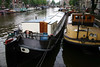 Houseboats along a canal in the Jordaan district - Amsterdam