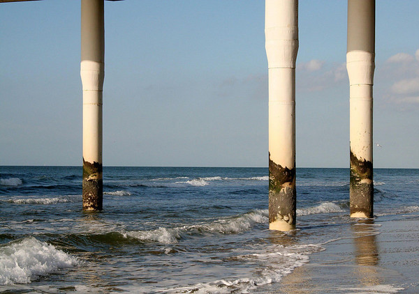 Concrete pier pilings of the Scheveningen Pier, at low tide in the North Sea - South Holland province