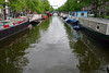 Houseboats along the canal to a drawbridge - in the Jordaan district - Amsterdam