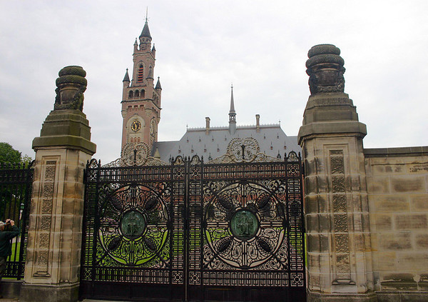 Entry gates to the Vredes Paleis (Peace Palace) - the gates were donated by Germany around 1911, they are made of cast iron and bear bronze medallions showing Lady Justice - located in The Hague - South Holland province