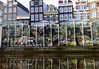 Bloemenmarkt (Flower Market) reflection upon the Singel Canal - with the merchant warehouses along the skyline - Amsterdam
