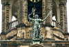 """Bronze statue of """"Peace"""", a personification of the peace treaty which had been concluded with the Spanish in 1648, when building work started upon this Royal Palace (originally the Town Hall of Amsterdam) - also this statue was intended to refer to the function of the Town Hall as a """"temple of peace""""  - with the sandstone bell tower in the background - Amsterdam"""