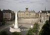 "The National Monument - across the Dam Square (town square, the place where early settlers built a dam on the Amstel River, thus giving ""Amsterdam"" its city name) - with the domed towered, Royal Palace, forming the western side of ""De Dam, as the Amsterdammers refer."