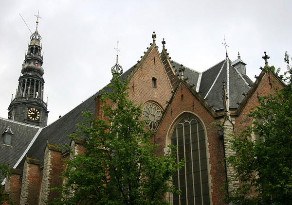 Oude Kerk (Old Church) - up to the bell tower and cross crowned spire - Old Center district - Amsterdam