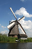 Kinderdink - across the catch water basin - to one of the thatch roof windmills from the mid 18th century - South Holland province