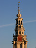 """Bell tower, spire and gilded cock atop the Zuider Kerk (South Church) - in the 9th century, the pope reportedly decreed that every church in Europe should show a cock on its dome or steeple, as a reminder of Jesus' prophecy that the cock would not crow the morning after the Last Supper, until the disciple Peter had denounced him three times (Luke 22:34), because of this story, """"weather cocks"""" have topped church steeples for centuries, both in Europe and in America - here in Amsterdam"""