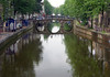 Triple bridge arch reflection on the canal - Amsterdam
