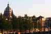 From the trees mostly blocking the merchant houses along the Kromme Waal (Waal Curve), street along the canal - to the cross-crowned spires atop the dome and twin towers of the St. Nicholas Church - Old Center district of Amsterdam