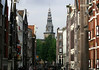 Along the historic merchant warehouses - to the tower and spire of the Oude Kerk (Old Church) - in the Old Center district, Amsterdam
