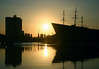 Sunrise over Oosterdok (East Dock) - with the sun at the bow of the NEMO Science Center - the old Amsterdam Harbor