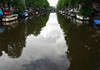 Cumulus cloud reflection upon the canal - Amsterdam