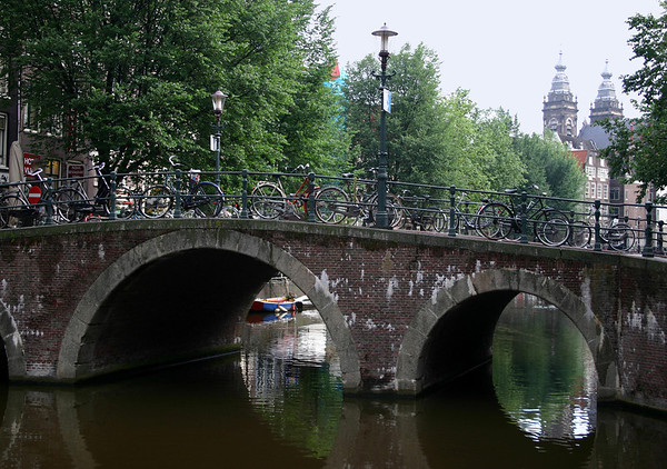 From a canal bridge in the Old Center district - to the western towers of the St. Nicholas Church - Amsterdam
