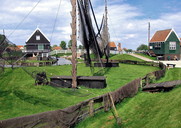 Zaanse Schans - Fishing nets and traps - with a triple stack lime kiln in the distance