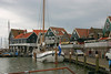 Netherlands flag flying from the wooden stern of the sail boat in the Volendam Harbor - North Holland province