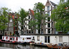 Canal Houseboats along the refurbished merchant warehouses - Amsterdam