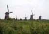 Kinderdijk - across the polder of Alblasserwaard, a drained and land reclaimed area, now a peat-bog area, used for agricultural purposes - to the 18th century windmills - South Holland province