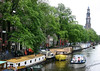Houseboats along a canal in the Old Center district - with the tower of the Zuiderkerk (South Church) in the background - Amsterdam
