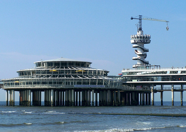 Scheveningen Pier complex on the North Sea - with the crane's boom supporting a bungy jump platform -  at the town of Scheveningen - South Holland province
