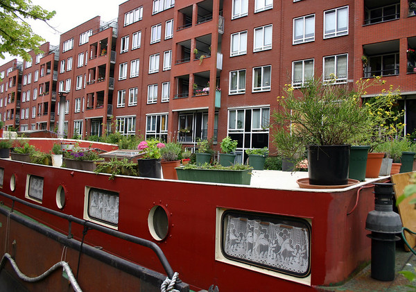 From the potted plants atop a houseboat - to the refurbished and modernized apartments in the Jordaan district - Amsterdam