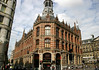 Magna Plaza (a shopping mall) - built in 1899 in neo-Gothic and neo-Renaissance style, it was once Amsterdam's Post Office building - with a small portion of the western facade of the Royal Palace to the right - Old Center district, Amsterdam