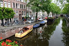 Houseboats and boats along a side canal in the Jordaan district - Amsterdam