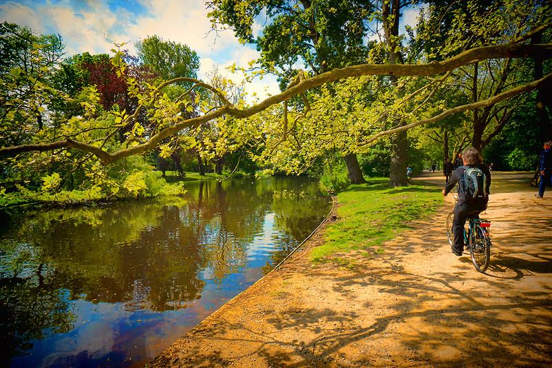 Biking through Vondelpark in Amsterdam