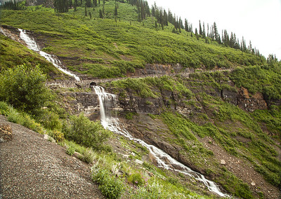 Waterfall-and bridge-mountainside-Sun-road-Glacier-National-Park-Montana-(c)-Bolio-Photography