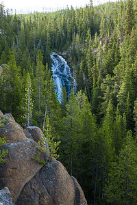 Waterfall -in-Yellowstone-National-Park-among-trees-and-rocks-Wyoming-(c)-Bolio-Photography