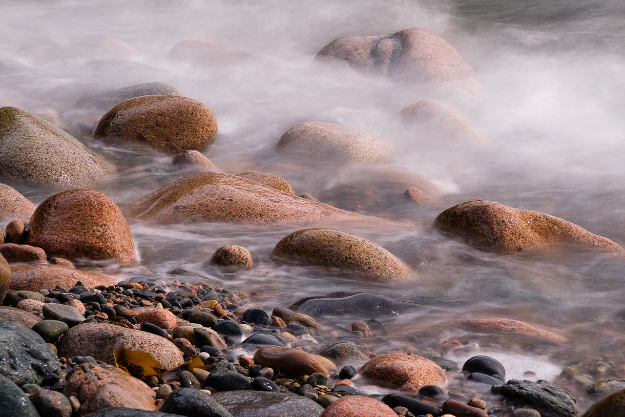 Moving Water Around Beach Rocks
