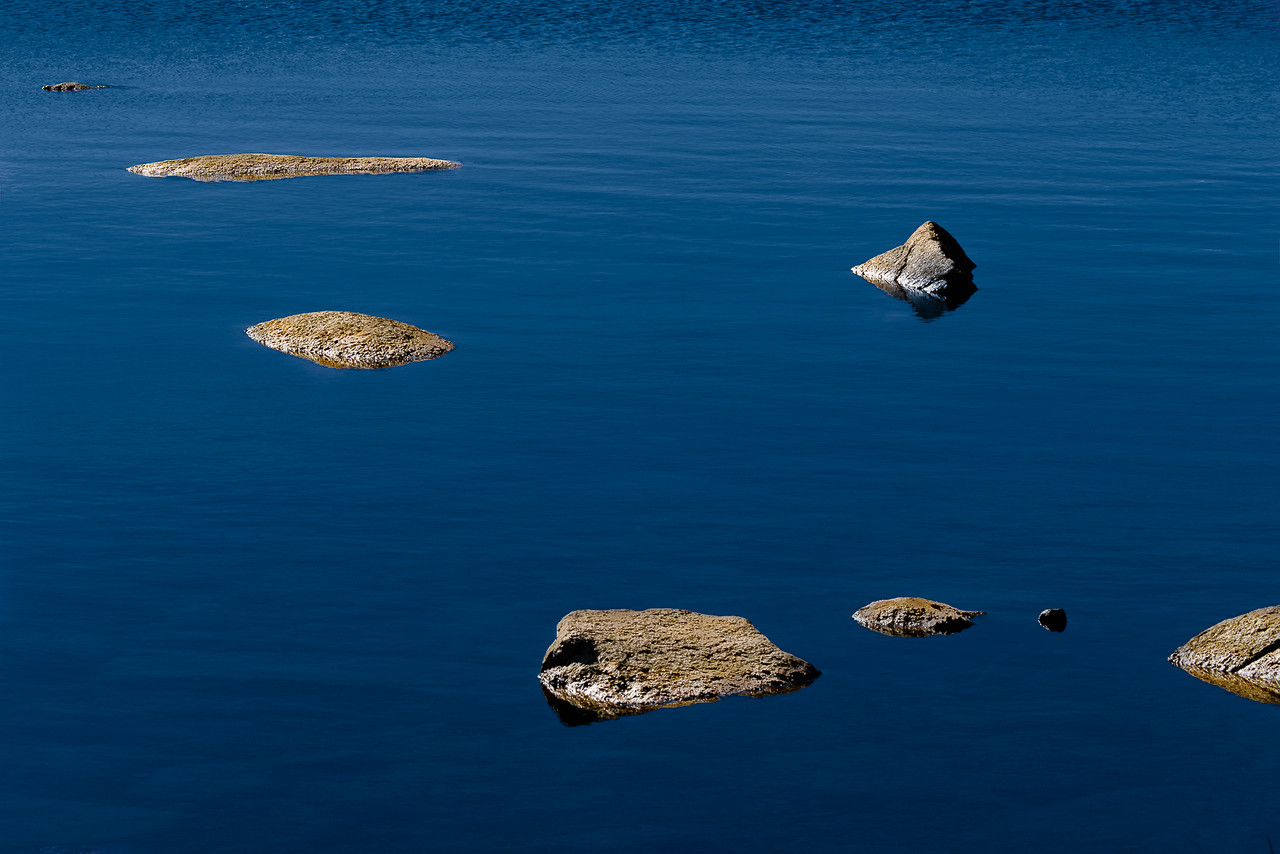 Rocks in Still Pond Waters