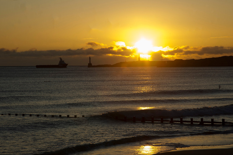 Boat going into Aberdeen Harbour at Sunrise.