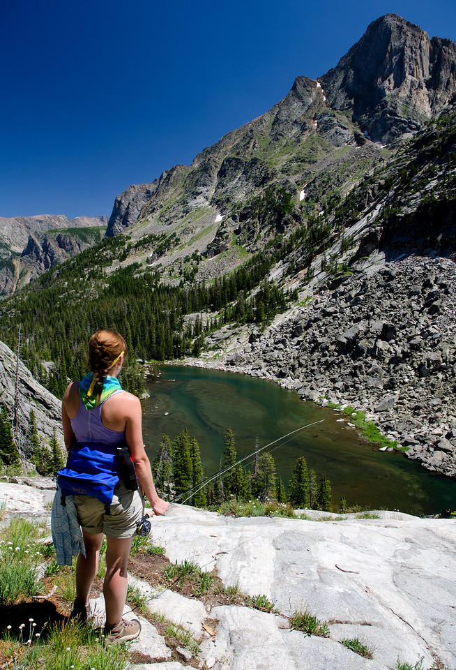An angler takes in the view above Dugan Lake in the Beartooth Mountains.