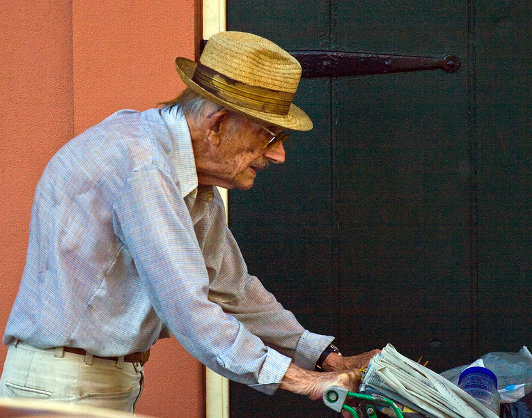 older gentleman pushing grocery cart in rain near Jackson Square New Orleans