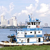 New Orleans across the river, Tug Les Limestone passing