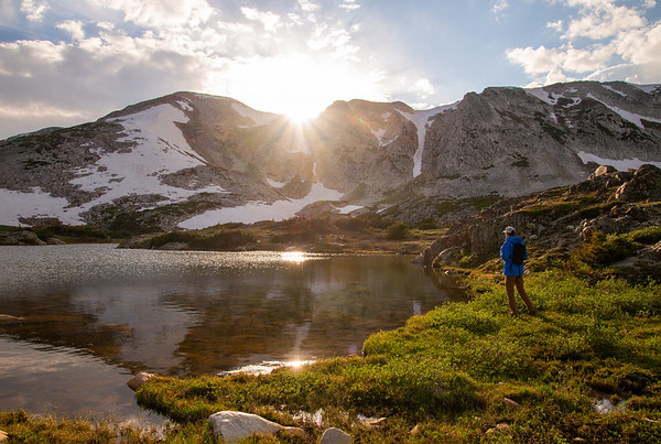 The sun sets behind Medicine Bow Peak in a peaceful lakes basin in southern Wyoming.
