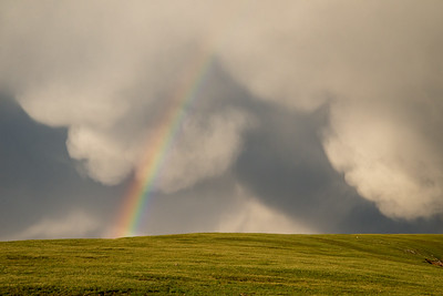 A rainbow appears beneath mammatus clouds in Rocky Mountain National Park in Colorado.