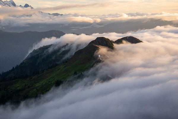 Clouds roll over a ridge in the Mount Baker Wilderness in Washington's North Cascades.